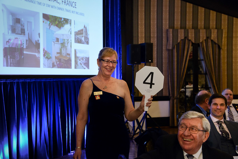 RTW Karen H smiles as Club President Terry D makes the top winning bid for the French Country Home 1 week stay!  Happy holidays Terry!