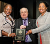 """Karen White-Roswell and Michelle Tomlinson representing The """"Purolator - Tackle Hunger"""" Program - accepting the RYIA """"Business"""" Award"""