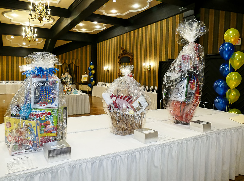 "The three ""themed"" raffle baskets always garner much interest: Kids games, Luxury Gifts for the ladies, and a Sports Basket."