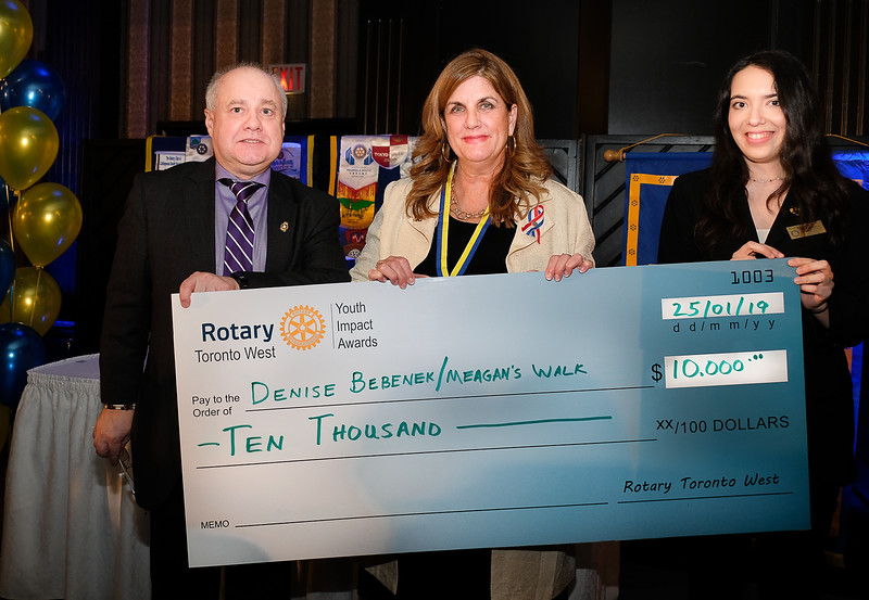"""The third presentation to Denise Bebenek was by RTW President Stephen Thiele presenting the cheque to Denise, in support of Meagan's Walk, the organization she founded following the death of her 5 year old daughter, Meagan due to a brain tumour. Over the past 17 years, Meagan's Walk has raised more than $5.4 million for paediatric brain tumour research."""""""