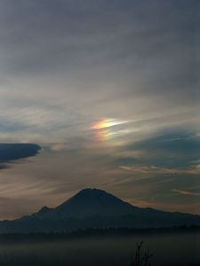 "Mount Rainier with a rainbow above, called a ""SunDog"".  Inelegant name for such a beautiful phenomenon..."