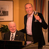 Rotary members Ron Manfield plays while Gaston toasts . . . .