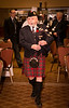 John Cameron piping in the haggis.