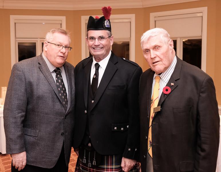 Rotarians John MacLellan and John Hastings with the Piper Dan MacDonald.