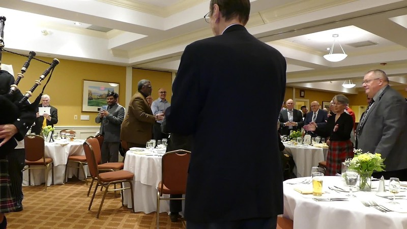 CLICK Center arrow to play VIDEO:  Address to the Haggis; comments by RTW President Stephen Thiele, then by Emcee John McLellan, then piping out the Haggis.