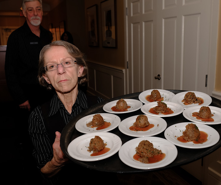"""First course is the Haggis. Our hard working server is normally quite smiley... caught at a """"busy"""" moment!"""