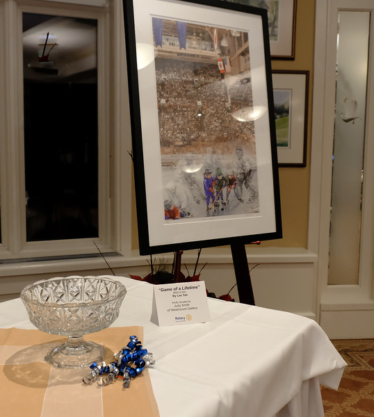 """Long time supporter of our Club Judy Smith of Westmount Gallery kindly donated a valuable framed hockey print """"Game of a Lifetime"""" by Les Tait."""