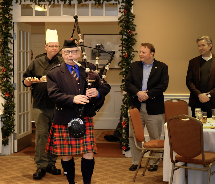 "The dinner commences with the traditional ""Piping in of the Haggis"" by John Cameron."