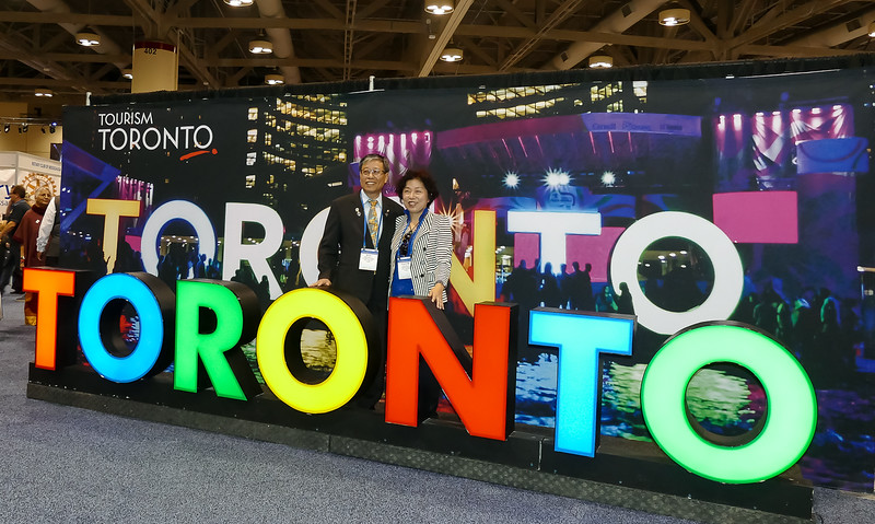 "Lots of photos taken with Toronto's emblematic ""signature"" sign!"