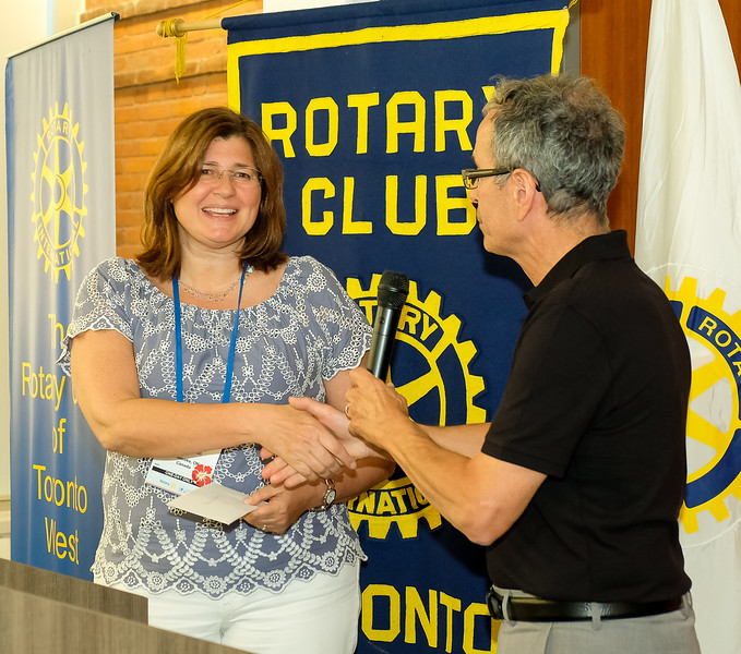 "RTW Community Chair John Muto presents Maria Pollieri of ""Days for Girls"" with a funding donation in support of this project to help ""Make a Difference""  for women around the world."