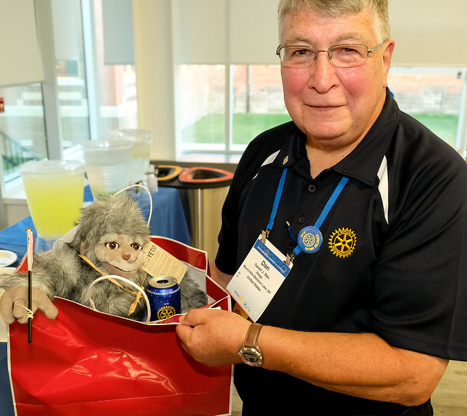 """Each guest was given a Canadian Gift Bag with a """"Yeti"""".  Holding his is Dan S from Burnt Hill Ballston Lake Rotary Club, NY."""