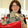 RTW Member Jeanne C showing us the YETI Gift Bags for each guest.