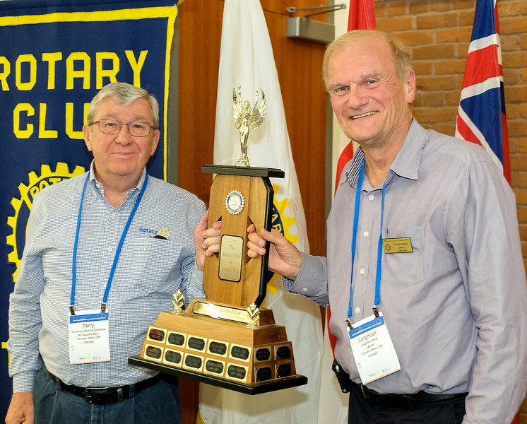 """RTW President (2017-18) Terry Donohue presented the club's Earl Laberge Award to Past President Leighton Reid for his dedication and enthusiastic support during his tenure with the club. Leighton and his wife Nancy have """"relocated and retired"""" to a beautiful golfing community on Georgian Bay, and will be missed. Please keep in touch Leighton!!"""