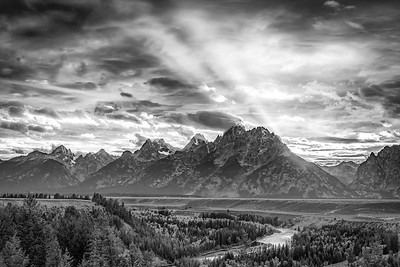 Fall sunset over the Grand Tetons, Teton National Park.  We drove through two days of storms and arrived in the park just in time to get a campsite, before driving to the Snake River Overlook to capture the setting sun.
