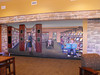The Wall of Honor Mural, painted by Brent McCarthy.  The woman in the center is Tye Preston, mother of Harry Preston.  Mr. Preston donated the land for the previous library building. The mural represents the library's past, present and future.<br /> (photo taken by David Jacobson)