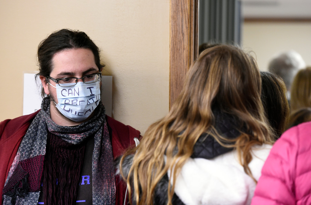 . Tristan, who refused to give his last name, wears a mask and stands next to a long line of concerned citizens during a public meeting on Monday with the Colorado Oil & Gas Conservation Commission  on Monday at the COGCC corporate office in Denver. The meeting gave citizens a chance to voice opinions on proposed spacing applications by Extraction Oil & Gas in Broomfield. For more photos and video of the meeting go to dailycamera.com Jeremy Papasso/ Staff Photographer/ Oct. 30, 2017