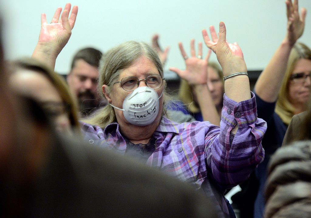 . Janice Brown, of Englewood, holds her hands up as she agrees with another citizen during a public meeting on Monday with the Colorado Oil & Gas Conservation Commission  on Monday at the COGCC corporate office in Denver. The meeting gave citizens a chance to voice opinions on proposed spacing applications by Extraction Oil & Gas in Broomfield. For more photos and video of the meeting go to dailycamera.com Jeremy Papasso/ Staff Photographer/ Oct. 30, 2017