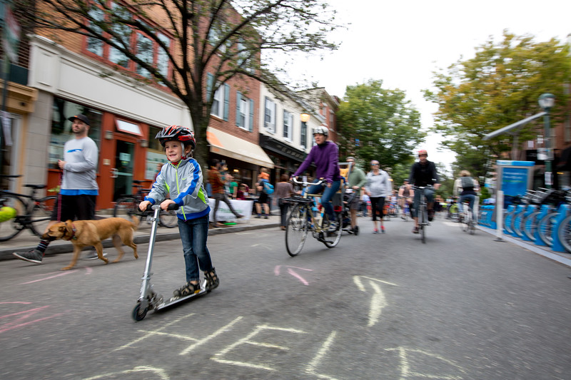 Zay Simons-Hanley, 5, rides his scooter in the street during Philadelphia's first Free Street event on September 24, 2016.