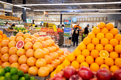 John Neal, produce team leader, stacks produce at Whole Foods in Newtown Square, which opened on January 18, 2019.