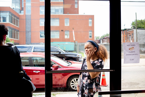 Angeliquie Howard-Johnson waits for her mother to buy a soft pretzel after worship at Zion Baptist Church at 3600 N Broad Street in North Philadelphia Sunday, August 18, 2019. The congregation gathered Sunday morning only two blocks from the site of a standoff between police and a gunman on the 3700 block of N 15th St. Wednesday evening.