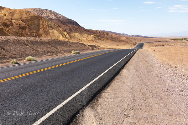 Badwater Road as it lines Black Mountains Range July 2018.  This is where I got stung by a wandering Tarantula Hawk Wasp as I sat down in my rental car.  Popped me on my right forearm as I brought my arm against my chest.  July 2018.