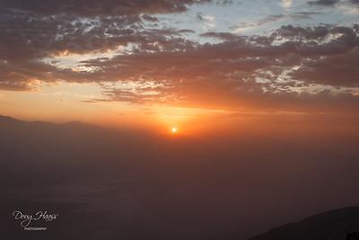 Dante's View at 5,400+ feet as a setting sun highlights the Saharan dust in Death Valley NP.  Badwater Salt Flats  are seen below through a dust haze.  July 12, 2021.