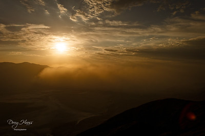 Dante's View at 5,400+ feet as a setting sun highlights the leading edge of a Saharan dust cloud moving south across Death Valley NP.  Badwater Salt Flats  are seen below through a dust haze.  July 12, 2021.