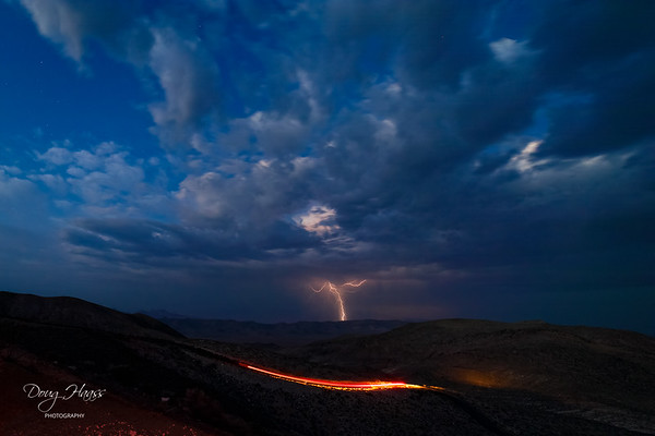 Lightning strike over North Las Vegas as the last car leaves for the day from Dante's View parking area.  July 12, 2021.