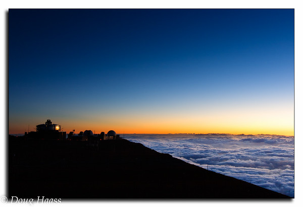 Sunset on Maui in Hawaii.  Observatory at 10, 025 feet on left.