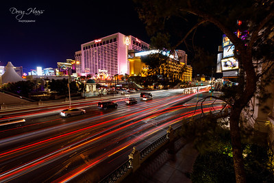 Light trails taken at night of Las Vegas Blvd. and Flamingo Road intersection, July 10, 2021.