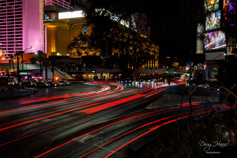 Light trails taken at night of Las Vegas Blvd. and Flamingo Road intersection, July 15, 2021.