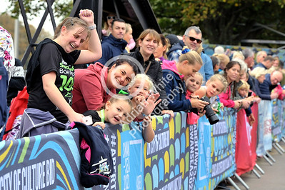 Admiral Swansea Bay 10k Race... Crowds applaud the runners at the finish line. BYLINE www.adrianwhitephotography.co.uk