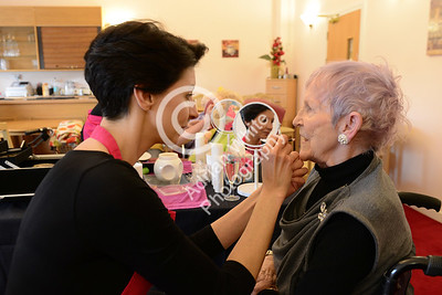 Beautician Kelly Anthony and Agi May giving their 'Beautiful You' makeover touch to residents of The Albert Edward Prince of Wales Court Residential Nursing Home...  Kelly Anthony offering her makeover magic to resident Angela Davies  Copyright © 2018 by Adrian White Photography, all rights reserved. For permission to publish - contact me via www.adrianwhitephotography.co.uk Please respect copyright laws.