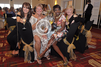 Jan Rees presents 'Going For Gold' charity fundraiser at the Marriot Hotel, Swansea. From left, Helen Bowden, Jan Rees, Joy Ogeh-Hutfield and Lynne Kettles