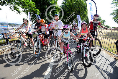 Gower Bike Ride.. start of the 35 mile annual bike ride starting from 360 Cafe around.  British Heart Foundation Ambassador Isobel Jones (centre) aged 12 riding after deciding she was strong enough on Friday.  PLEASE BYLINE - click4prints.com   Copyright © 2018 by Adrian White  Photography, all rights reserved. For permission to publish - contact me via www.adrianwhitephotography.co.uk Please respect copyright laws.