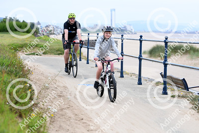 Gower Bike Ride 2021 juniors 8 mile ride out along Swansea Promenade.     Copyright © 2021 by Adrian White  Photography, all rights reserved. For permission to publish - contact me via www.adrianwhitephotography.co.uk Please respect copyright laws.