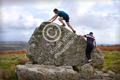 Gower Living... Ramblers climb Arthur's Stone on Cefn Bryn Common.