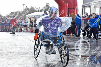 Llanelli Half Marathon 2020. 1500 runners taking part in the annual dash around the town of Llanelli, starting and ending at Parc y Scarlets.  Wheelchair competitor, Steve Walford   PLEASE BYLINE click4prints.com  Copyright © 2020 by Adrian White  Photography, all rights reserved. For permission to publish - contact me via www.adrianwhitephotography.co.uk Please respect copyright laws.