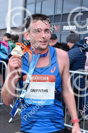 Llanelli Half Marathon 2020. 1500 runners taking part in the annual dash around the town of Llanelli, starting and ending at Parc y Scarlets.  Winner of the mens race, Dewi Griffiths  PLEASE BYLINE click4prints.com  Copyright © 2020 by Adrian White  Photography, all rights reserved. For permission to publish - contact me via www.adrianwhitephotography.co.uk Please respect copyright laws.