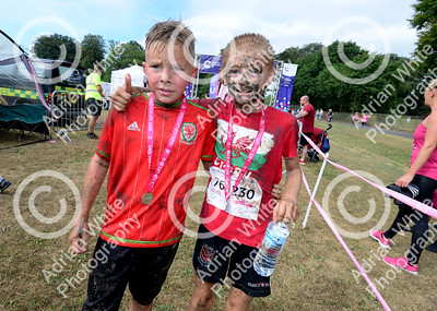 Cancer Research Pretty Muddy 5k obstacle course, Singleton Park, Swansea.  Sean Richards aged 11 and Daniel May aged 10  Copyright © 2018 by Adrian White  Photography, all rights reserved. For permission to publish - contact me via www.adrianwhitephotography.co.uk Please respect copyright laws.