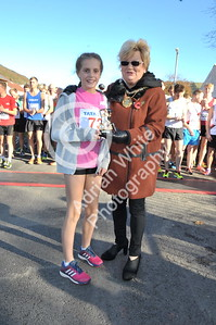 EAST / Copyright Adrian White Sunday 6th November 2016 Richard Burton 10k Road Race, Cwmavon. Runner up Madison Hines presented by Deputy Mayor Janice Dudley.