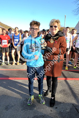 EAST / Copyright Adrian White Sunday 6th November 2016 Richard Burton 10k Road Race, Cwmavon. Joshua Wallace winner of the Boys Junior Race with presentation by Deputy Mayor of Neath Port Talbot Janice Dudley.