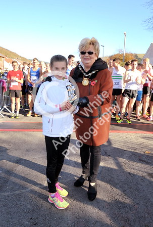 EAST / Copyright Adrian White Sunday 6th November 2016 Richard Burton 10k Road Race, Cwmavon. Winner Lilly Jones presented by Deputy Mayor Janice Dudley.