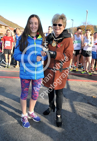 EAST / Copyright Adrian White Sunday 6th November 2016 Richard Burton 10k Road Race, Cwmavon. Runner up Eden Rae Davies presented by Deputy Mayor Janice Dudley.