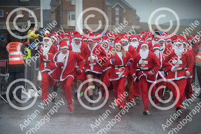Santa 5km Run by the seaside was back for its 5th year on for a windswept, rainsoaked exciting 5k race on the sea front Aberavon.   Copyright © 2018 by Adrian White  Photography, all rights reserved. For permission to publish - contact me via www.adrianwhitephotography.co.uk Please respect copyright laws.