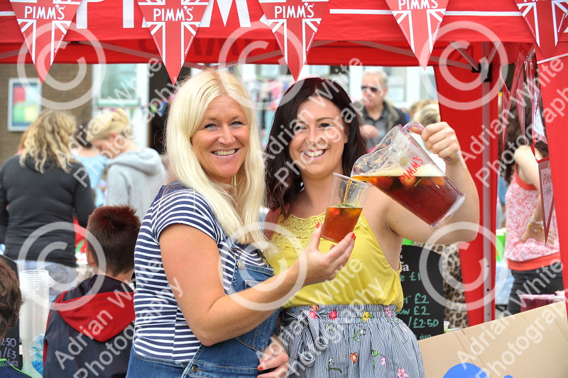 Newton Primary School, Swansea... Community fun and fundraising at the primary school's summer celebration.. Rachel Fender and daughter Rosie preparing Pimms for parents.