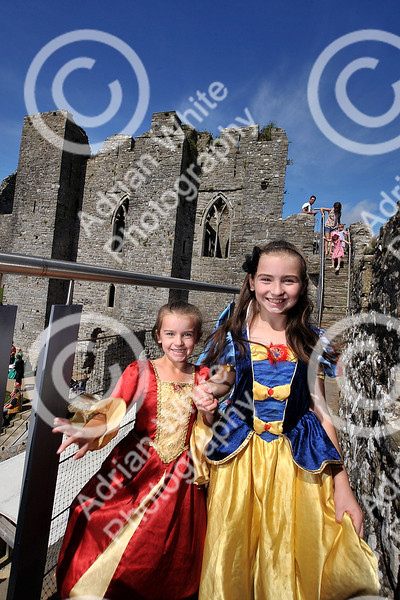 Princess Day at Oystermouth Castle, Mumbles. Sisters Kiera John aged 7 and Alliesha John aged 9 on the battlements of Oystermouth Castle.