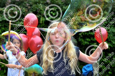 Newton Primary School, Swansea... Community fun and fundraising at the primary school's summer celebration.. Imogen Lempriere aged 9 creating colossal air balloons.