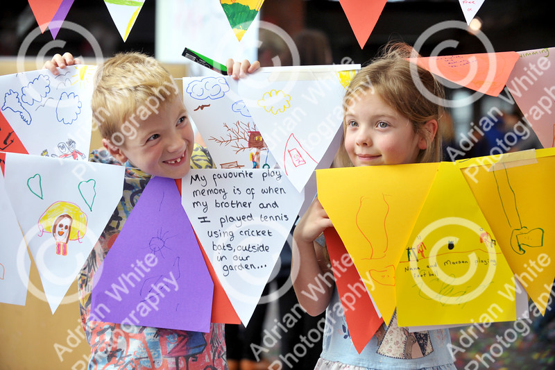 Young children had a ball celebrating National Playday at the National Waterfront Museum.. pictured.. Twins, James and Lilly Maddock aged 6 amongst the handmade celebration bunting.  Swansea Council organised the event which was also a celebration of the 20th anniversary of the authority having a play team. Activities at the event included the Play on Wheels Playbus, Interplay Pirate Ship, Circus Eruption, Park Lives and the chance to take part in some old fashioned games.