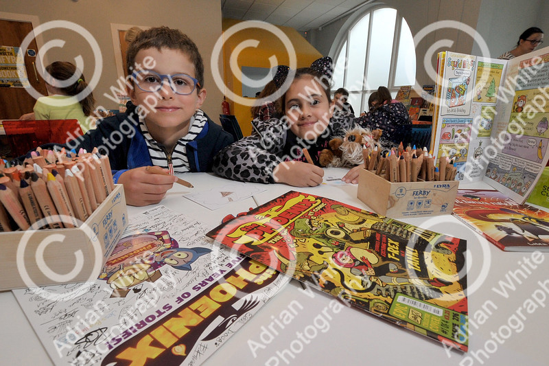 Dylan Thomas Centre Holiday Comic Book Workshop Alessio Pace aged 8 and Alessandra Catalano aged 8 (both correct) getting animated and creative at the free comic workshop at the Dylan Thomas Centre, Swansea